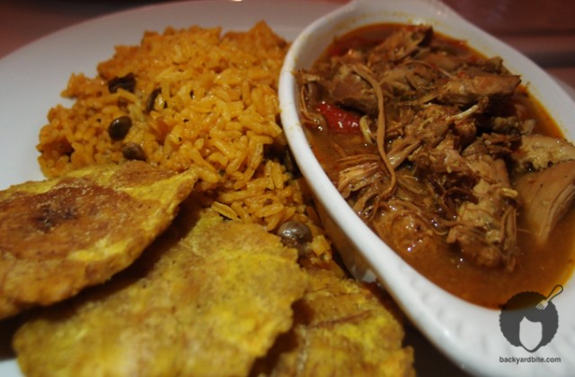 Pollo guisado and tostones y arroz con gandules